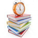 stock-photo-alarm-clock-standing-on-stack-of-books-d-isolated-on-white-85822024